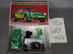Bandai - A boxed vintage Bandai 1:20 scale Porsche 911 Turbo plastic model kit.