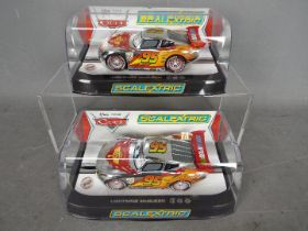 Scalextric - 2 x Pixar Cars Lightning McQueen models in the rare chrome finish,