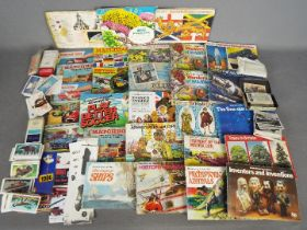 Matchbox - A collection of nine vintage Matchbox catalogues with approximately 20 Brooke Bond Tea
