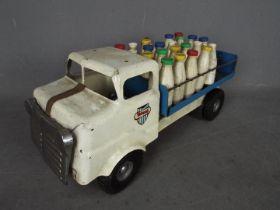 Triang - An unboxed Triang Junior Diesel Series pressed steel Milk Lorry.