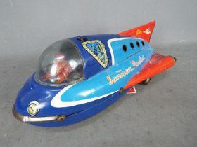 Masudaya - A vintage unboxed Japanese tinplate Sonicon Rocket by Masudaya (Modern Toys of Japan).