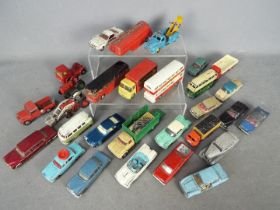 Dinky Toys, Corgi Toys, Budgie - An unboxed grouping of diecast model vehicles.