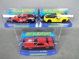Scalextric - 3 x cars, a Dodge Challenger T/A, 2 x Chevrolet Corvette C6R models.