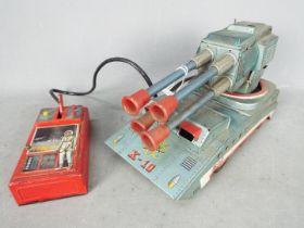 Suzuki & Edwards - An unboxed vintage Japanese tinplate Atomic X-10 Pom Pom Tank by Suzuki &