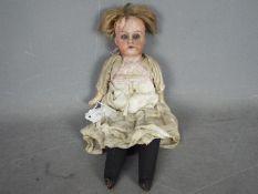 Unconfirmed Maker - A German cabinet doll possibly by Kestner.