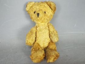 An unmarked vintage teddy bear measuring approximately 18cms in height,
