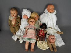 Armand Marseille, Reliable, Others - A group of vintage dolls made from various materials.