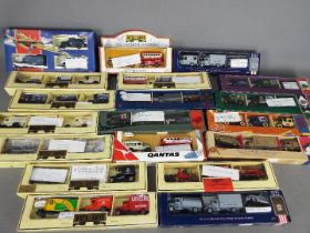 Lledo - A group of 19 x box sets of vehicles including # DML1003 Dambusters three vehicle pack,
