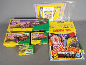 Corgi Classics - A collection of 4 x boxed Showmans Range items with associated posters.