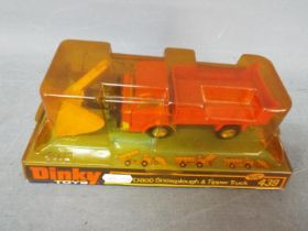 Dinky - A boxed # 439 Ford D800 Snowplough & Tipper Truck with orange cab and back.