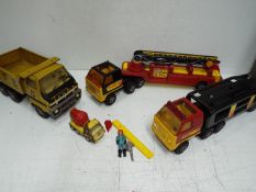 Tonka - Four vehicles and two figures.