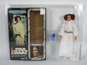 "Star Wars, Kenner - A graded Kenner 1977 Star Wars 'Princess Leia' large 12"" action figure."