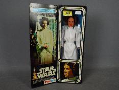 Palitoy - A boxed Princess Leia Organa figure. # 33327. She stands 11.