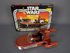 Star Wars - A boxed, vintage, Kenner Star Wars Landspeeder, with crad insert,