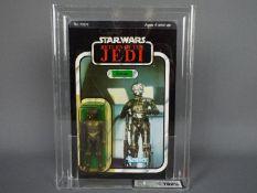 """Star Wars, Kenner - A graded Kenner 1983 Star Wars ROTJ 'Zuckuss' 3/4"""" action figure."""