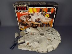Star Wars - A boxed, vintage, Millennium Falcon Vehicle by Kenner, with accessories,