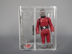 Star Wars - A loose vintage and graded Star Wars 'A New Hope' 3 3/4 action figure 'Snaggletooth' .