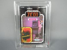 """Star Wars, Kenner - A graded Kenner 1983 Star Wars ROTJ 'Power Droid' 3 3/4"""" action figure."""