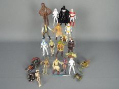 Star Wars - A quantity of unboxed action figures to include Chewbacca, Yoda, Darth Vader, Han Solo,