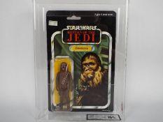 "Star Wars, Palitoy - A graded Palitoy 1983 Star Wars ROTJ 'Chewbacca' 3 3/4""action figure."