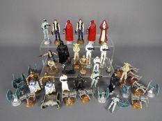 A La Carte - Lucas Film - A set of 16 x Star Wars chess figures, 8 x cast metal figures.