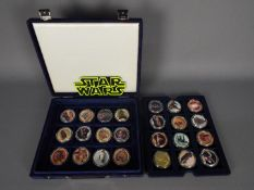 Star Wars - Hollywood Super Star - A cased set of 24 x gold coloured coins with colour images on