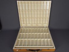 """A wooden action figure carry case with 94 internal compartments suitable for 3¾"""" action figures."""