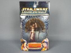 """Star Wars - Hasbro - An 8"""" Princess Leia figure from the Unleashed series dated 2002. # 84936."""