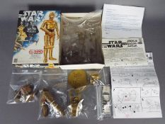 """Star Wars, Denys Fisher - A boxed vintage Denys Fisher Star Wars C-3PO 10"""" tall plastic model kit."""