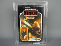 "Star Wars, Kenner - A graded Kenner 1983 Star Wars ROTJ 'Ugnaught' 3 3/4"" action figure."
