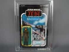 "Star Wars, Kenner - A graded Kenner 1983 Star Wars ROTJ 'AT-AT Commander' 3 3/4"" action figure."