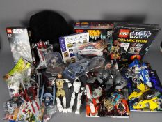 Star Wars - Lego - A quantity of unboxed Lego Star Wars figures and vehicles including Obi-Wan