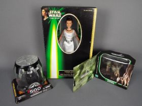 Star Wars, Hasbro - Three boxed Star Wars action figures in various sizes.