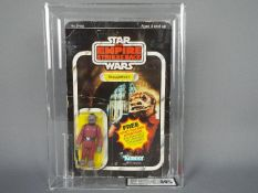 "Star Wars, Kenner - A graded Kenner 1980 Star Wars TESB 'Snaggletooth' 3 3/4""action figure."