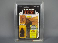 """Star Wars, Kenner - A graded Kenner 1983 Star Wars ROTJ 'Jawa' with coin promo 3 3/4"""" action figure."""
