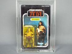 "Star Wars, Kenner - A graded Kenner 1983 Star Wars ROTJ 'Rancor Keeper' 3 3/4"" action figure."