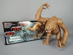 Star Wars - A boxed, vintage, Rancor Monster action figure in tri-logo box, no instructions,