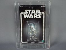 """Star Wars, Hasbro - A graded Kenner 2001 Star Wars Silver Anniversary 'R2-D2' 3 3/4"""" action figure."""