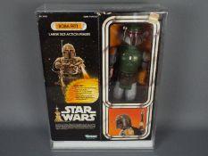 """Star Wars, Kenner - A boxed vintage Kenner 1980 Star Wars 'Boba Fett' large 12"""" action figure."""