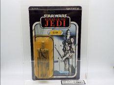 """Star Wars, Kenner - A graded Kenner 1983 Star Wars ROTJ 'IG-88' 3 3/4""""action figure."""