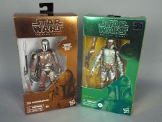 Star Wars, Hasbro - Two boxed Hasbro Star Wars 'The Black Series' Carbonised action figures.