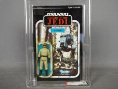 "Star Wars, Kenner - A graded Kenner 1984 Star Wars ROTJ AT-ST Driver3 3/4"" action figure."