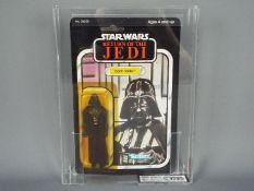 """Star Wars, Kenner - A graded Kenner 1983 Star Wars ROTJ 'Darth Vader' 3 3/4""""action figure."""