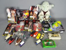 Star Wars, Hasbro - Two boxed Star Wars vehicles, a Star Wars soft toy of Yoda,