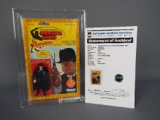 """Kenner - A graded Kenner 1982 Indiana Jones in Raiders of the Lost Ark 'TOHT' 3 3/4"""" action figure."""