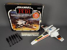 Star Wars - A boxed, vintage Kenner X Wing Fighter Vehicle with Battle Damaged look feature,