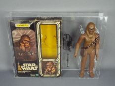 """Star Wars, Denys Fisher - A vintage and graded 12"""" action figure of Chewbacca by Kenner."""