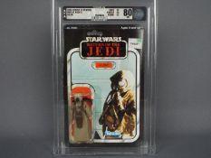 """Star Wars, Kenner - A graded Kenner 1983 Star Wars ROTJ '4-Lom' 3 3/4"""" action figure."""