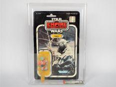 "Star Wars, Kenner - A graded Kenner 1980 Star Wars TESB 'Yoda' 3 3/4""action figure."