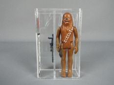 Star Wars - A loose vintage and graded Star Wars 'A New Hope' 3 3/4 action figure 'Chewbacca'.